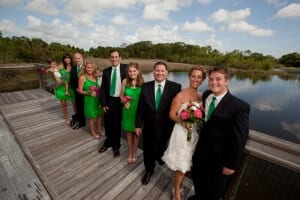 Wedding party on deck by wetlands