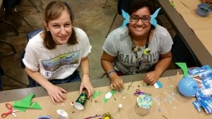 Teens making arts and crafts