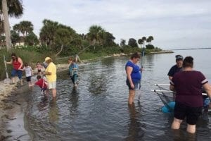 family dip netting in the Indian River Lagoon