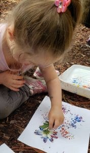 Child painting with flower