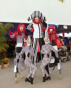 Performers on stilts