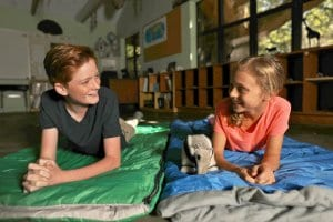 Kids in sleeping bags during overnight program