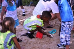 Students digging in the sand