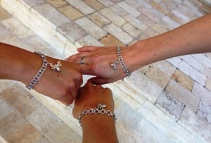 Group members show off bracelets