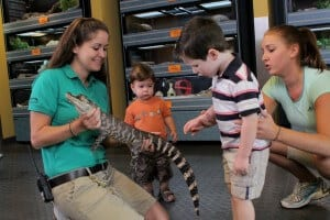 Keeper showing young zoo guests an animal at Wildlife Detective Training Academy