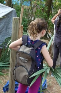 Girl wearing Family Nature Club backpack