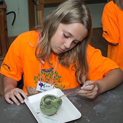Girl working on art project during Art Camp
