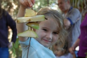 child holding apple animal enrichment