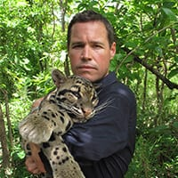 Jeff Corwin holding young snow leopard
