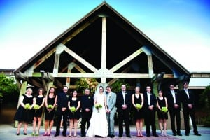 Wedding party in front of lodge
