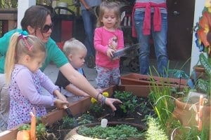 children planting in the zoo garden