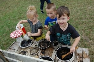 children making mud pies