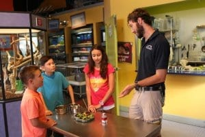 Zookeeper talking with children in Wildlife Detective Training Academy