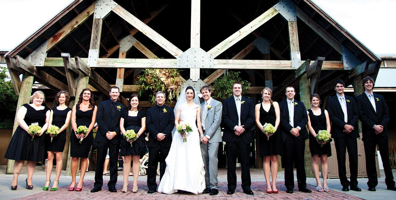 Wedding party poses in front of lodge