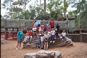Zoo Explorers students on a large rock in playground